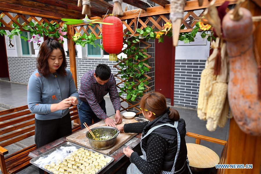 Duan Suhua (L), who runs a hostel, makes dumplings for tourists at her farmhouse in Niangziguan Village of Niangziguan Town in Pingding County, north China\'s Shanxi Province, on Feb. 26, 2019. China\'s efforts and success in poverty reduction can help other developing nations, said experts observing the country\'s ongoing Two Sessions. The Two Sessions refer to the annual gatherings of the National People\'s Congress (NPC) and the National Committee of the Chinese People\'s Political Consultative Conference, China\'s top legislature and political advisory body respectively. China has emerged as a global role model with efforts in structural transformation and industrial upgrading, lifting hundreds of millions of people out of poverty, said retired Lieutenant Colonel Muhammad Faruk Khan, a presidium member of Bangladesh\'s ruling Awami League. (Xinhua/Cao Yang)  China\'s efforts and success in poverty reduction can help other developing nations, said experts observing the country\'s ongoing Two Sessions.  The Two Sessions refer to the annual gatherings of the National People\'s Congress (NPC) and the National Committee of the Chinese People\'s Political Consultative Conference, China\'s top legislature and political advisory body respectively.  China has emerged as a global role model with efforts in structural transformation and industrial upgrading, lifting hundreds of millions of people out of poverty, said retired Lieutenant Colonel Muhammad Faruk Khan, a presidium member of Bangladesh\'s ruling Awami League.  In the government work report delivered at the opening of the annual NPC session on Tuesday, Premier Li Keqiang pledged that China will reduce its rural poor population by over 10 million this year.  Official figures show that over the past 40 years, China has lifted more than 700 million rural residents out of poverty, and the poverty rate, proportion of people living below the Chinese poverty line, had fallen among rural population from 97.5 percent in 1