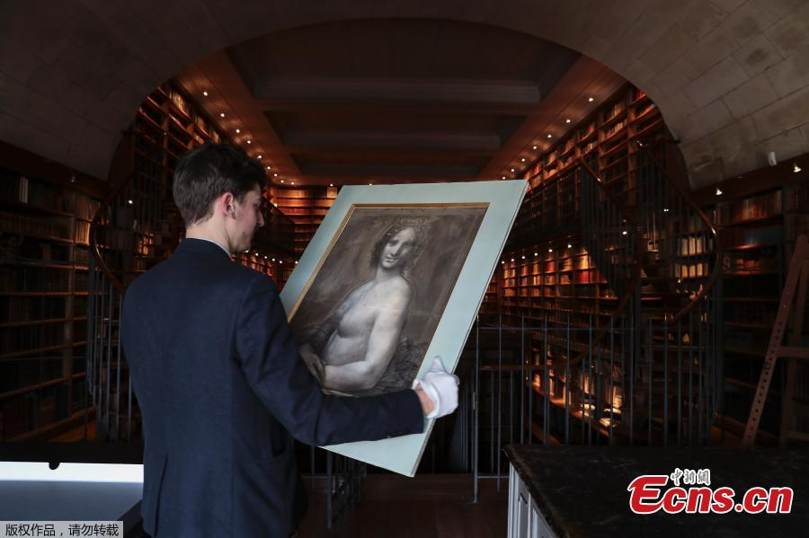 Curator at the Conde Museum Mathieu Deldicque holds a charcoal drawing known as the \