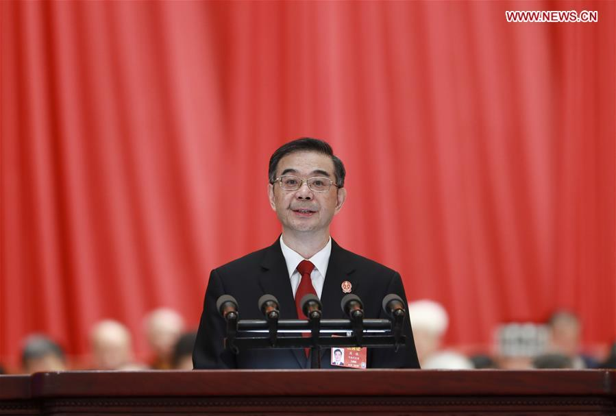 Chief Justice Zhou Qiang delivers a work report of the Supreme People\'s Court (SPC) at the third plenary meeting of the second session of the 13th National People\'s Congress (NPC) at the Great Hall of the People in Beijing, capital of China, March 12, 2019. (Xinhua/Pang Xinglei)