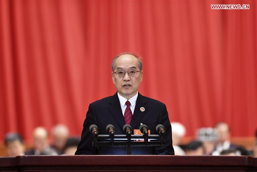 Zhang Jun, procurator-general of the Supreme People\'s Procuratorate (SPP), delivers a report on the SPP\'s work at the third plenary meeting of the second session of the 13th National People\'s Congress (NPC) at the Great Hall of the People in Beijing, capital of China, March 12, 2019. (Xinhua/Yan Yan)