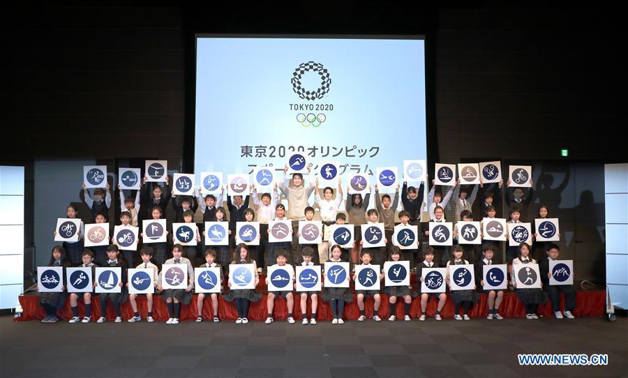 Athletes and children unveil the sport pictograms for the Tokyo 2020 Summer Olympic Games with children at the unveiling event in Tokyo, Japan, on March 12, 2019. (Xinhua/Du Xiaoyi)