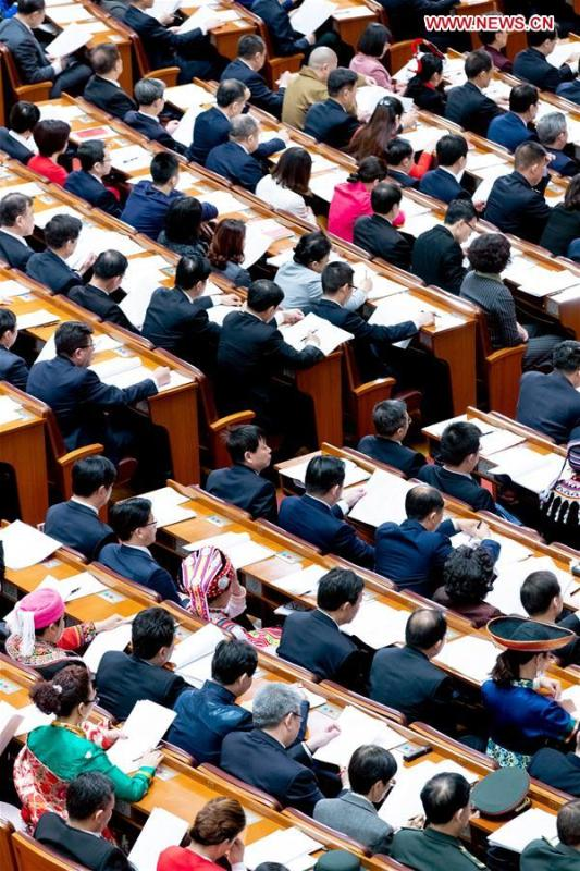 The third plenary meeting of the second session of the 13th National People\'s Congress (NPC) is held at the Great Hall of the People in Beijing, capital of China, March 12, 2019. (Xinhua/Liu Bin)