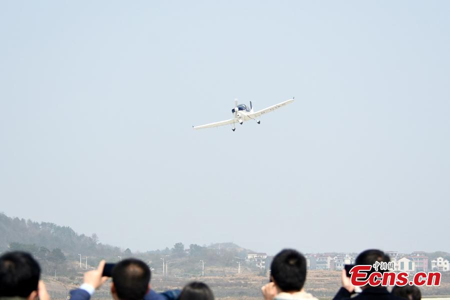 An aircraft developed by Guanyi General Aviation undergoes a test flight at Hengdian Airport in Zhejiang Province, March 11, 2019. The private company said independent intellectual property rights had been secured for the general-purpose aircraft GA20. The 30-minute test flight showed the aircraft flew smoothly and landed safely. (Photo provided to China News Service)
