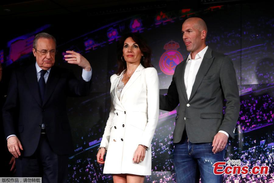 Newly appointed Real Madrid head coach Zinedine Zidane and his wife meet the press in Madrid, March 11, 2019. (Photo/Agencies)