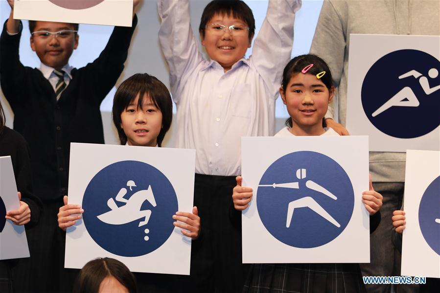 Children display sport pictograms for the Tokyo 2020 Summer Olympic Games at the unveiling event in Tokyo, Japan, on March 12, 2019. (Xinhua/Du Xiaoyi)