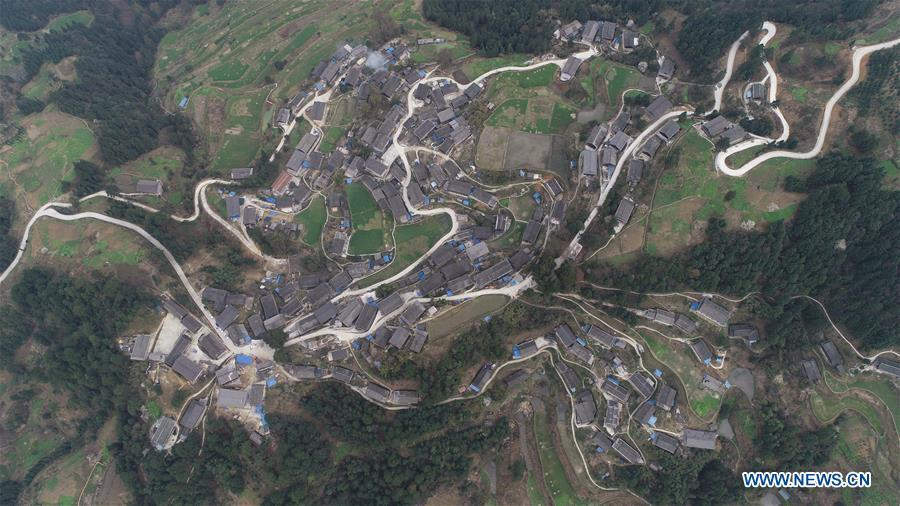 Aerial Photo taken on March 12, 2019 shows the winding concrete road at Paijie Village of Paidiao Township in Danzhai County, Miao and Dong Autonomous Prefecture of Qiandongnan, southwest China\'s Guizhou Province. The concrete road project in Guizhou was launched in August, 2017. Up to now, Guizhou has seen 77,700 kilometers of rural roads built or renovated with nearly 40,000 villages connected by concrete roads. Tens of millions of rural people benefit from the project. (Xinhua/Yang Wukui)