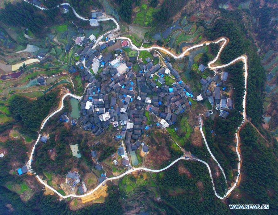 Aerial Photo taken on March 12, 2019 shows the winding concrete road at Donglong Village of Gedong Township in Jianhe County, Miao and Dong Autonomous Prefecture of Qiandongnan, southwest China\'s Guizhou Province. The concrete road project in Guizhou was launched in August, 2017. Up to now, Guizhou has seen 77,700 kilometers of rural roads built or renovated with nearly 40,000 villages connected by concrete roads. Tens of millions of rural people benefit from the project. (Xinhua/Fang Peng)