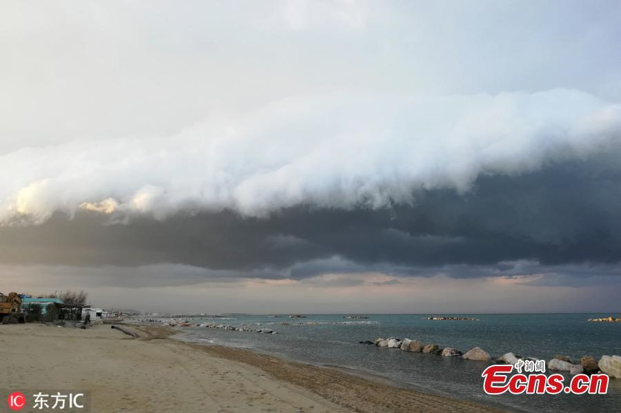Photo taken on March 11, 2019 shows the stunning view of shelf cloud over Pescara, Italy.  (Photo/IC)