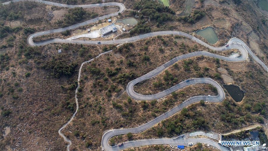 Aerial Photo taken on March 11, 2019 shows the winding concrete road from Kaili City to Dangguo Village in southwest China\'s Guizhou Province. The concrete road project in Guizhou was launched in August, 2017. Up to now, Guizhou has seen 77,700 kilometers of rural roads built or renovated with nearly 40,000 villages connected by concrete roads. Tens of millions of rural people benefit from the project. (Xinhua/Wu Jibin)