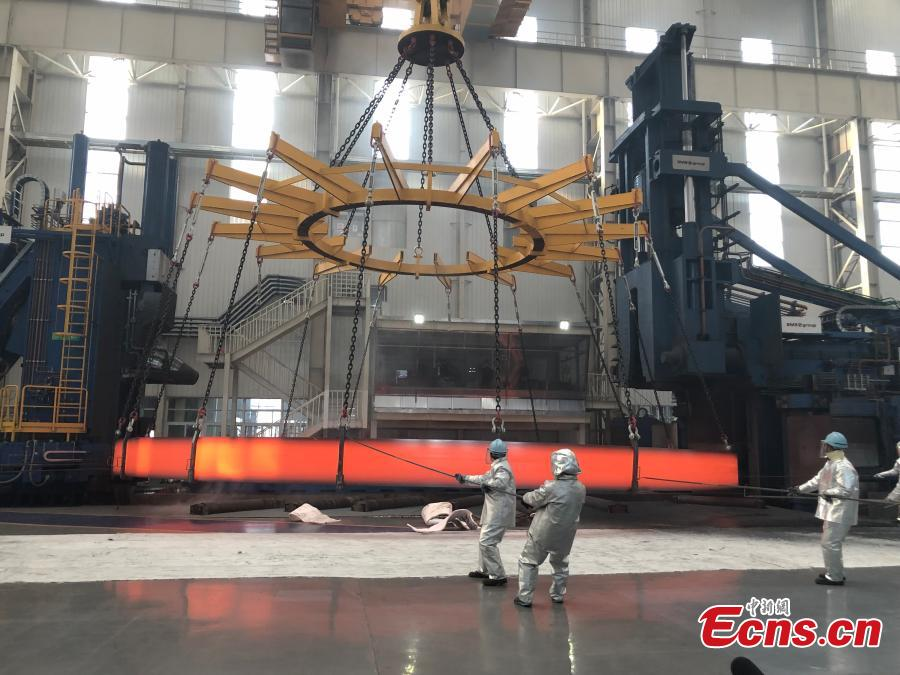 A non-welded stainless steel ring, the world's largest of its kind, is unveiled by the Institute of Metal Research at the Chinese Academy of Sciences, March 12, 2019. The ring, made by the institute using its own technologies, has a diameter of 15.6 meters and weighs 150 tons, setting a world record. It will be used in China\'s fourth-generation nuclear power reactor. (Photo: China News Service/Liu Yan)