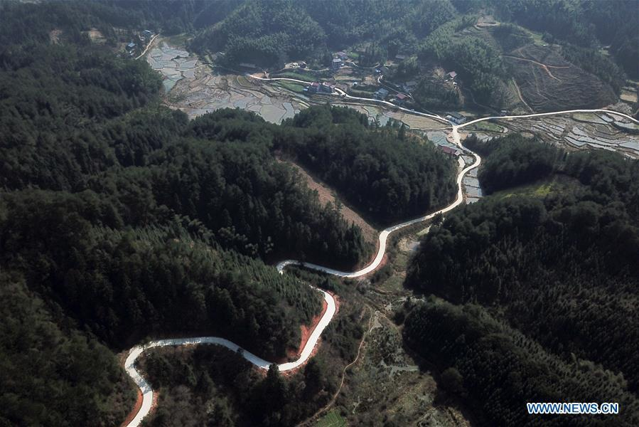 Aerial Photo taken on March 11, 2019 shows the winding concrete road at Chalu Village of Tonggu Township in Jinping County, Miao and Dong Autonomous Prefecture of Qiandongnan, southwest China\'s Guizhou Province. The concrete road project in Guizhou was launched in August, 2017. Up to now, Guizhou has seen 77,700 kilometers of rural roads built or renovated with nearly 40,000 villages connected by concrete roads. Tens of millions of rural people benefit from the project. (Xinhua/Peng Zeliang)