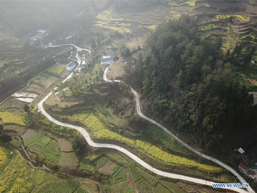 Aerial Photo taken on March 12, 2019 shows the winding concrete road at Kuilong Village of Baini Township in Yuqing County, Zunyi City, southwest China\'s Guizhou Province. The concrete road project in Guizhou was launched in August, 2017. Up to now, Guizhou has seen 77,700 kilometers of rural roads built or renovated with nearly 40,000 villages connected by concrete roads. Tens of millions of rural people benefit from the project. (Xinhua/He Chunyu)