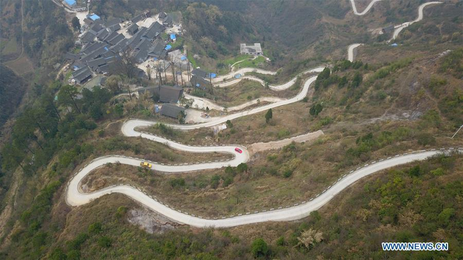 Aerial Photo taken on March 12, 2019 shows the winding concrete road at Longjiang Village of Xuanwei Township in Majiang County, Miao and Dong Autonomous Prefecture of Qiandongnan, southwest China\'s Guizhou Province. The concrete road project in Guizhou was launched in August, 2017. Up to now, Guizhou has seen 77,700 kilometers of rural roads built or renovated with nearly 40,000 villages connected concrete roads. Tens of millions of rural people benefit from the project. (Xinhua/Cai Xingwen)