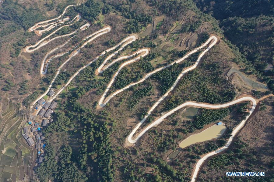 Aerial Photo taken on March 11, 2019 shows the winding concrete road at Jiame Village of Gangbian Township in Congjiang County, Miao and Dong Autonomous Prefecture of Qiandongnan, southwest China\'s Guizhou Province. The concrete road project in Guizhou was launched in August, 2017. Up to now, Guizhou has seen 77,700 kilometers of rural roads built or renovated with nearly 40,000 villages connected by concrete roads. Tens of millions of rural people benefit from the project. (Xinhua/Luo Jinglai)