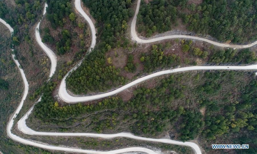 Aerial Photo taken on March 12, 2019 show the winding concrete road at Lianhua Village of Longshan Township in Longli County, Bouyei-Miao Autonomous Prefecture of Qiannan, southwest China\'s Guizhou Province. The concrete road project in Guizhou was launched in August, 2017. Up to now, Guizhou has seen 77,700 kilometers of rural roads built or renovated with nearly 40,000 villages connected by concrete roads. Tens of millions of rural people benefit from the project. (Xinhua/Long Yi)
