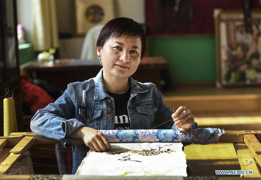 Renagul embroiders for haute couture at her workshop in Yizhou District of Hami City, northwest China\'s Xinjiang Uygur Autonomous Region, on March 8, 2019. The haute couture, literally named \