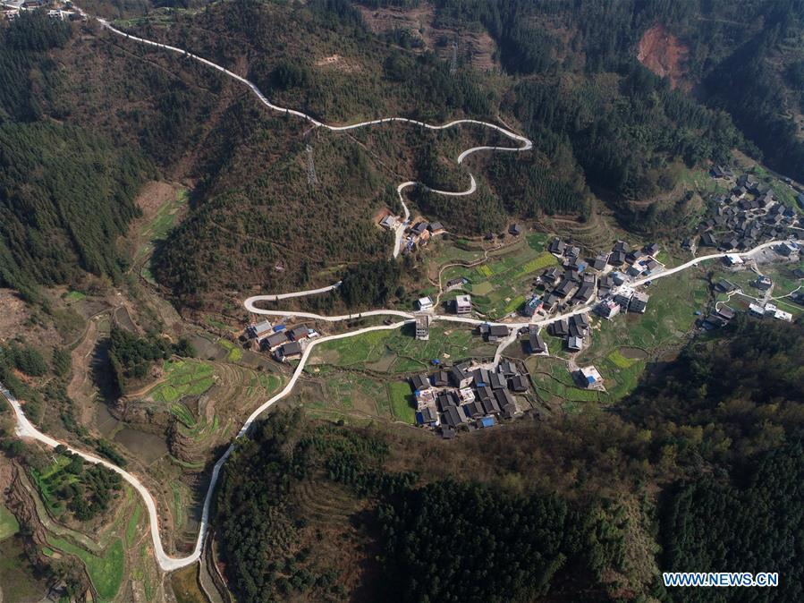 Aerial Photo taken on March 11, 2019 shows the winding concrete road at Zaigao Village of Guzhou Township in Rongjiang County, Miao and Dong Autonomous Prefecture of Qiandongnan, southwest China\'s Guizhou Province. The concrete road project in Guizhou was launched in August, 2017. Up to now, Guizhou has seen 77,700 kilometers of rural roads built or renovated with nearly 40,000 villages connected by concrete roads. Tens of millions of rural people benefit from the project.(Xinhua/Wu Dechang)