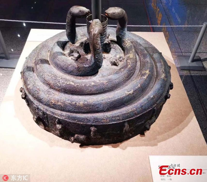 The bronze stand of a Jiangu, a large barrel drum mounted on a pole, is on display at the Shanxi Museum in Taiyuan City, Shanxi Province, March 14, 2019 as police hold an exhibition to display relics they have recovered. A first-class national cultural relic, the stand from the Warring States Period (475-221 B.C.) features three snakes and delicate images of several other animals. With a diameter of 77 centimeters and 47 centimeters tall, it weighs 80 kilograms, making it the largest and heaviest drum stand ever excavated in China. (Photo/IC)