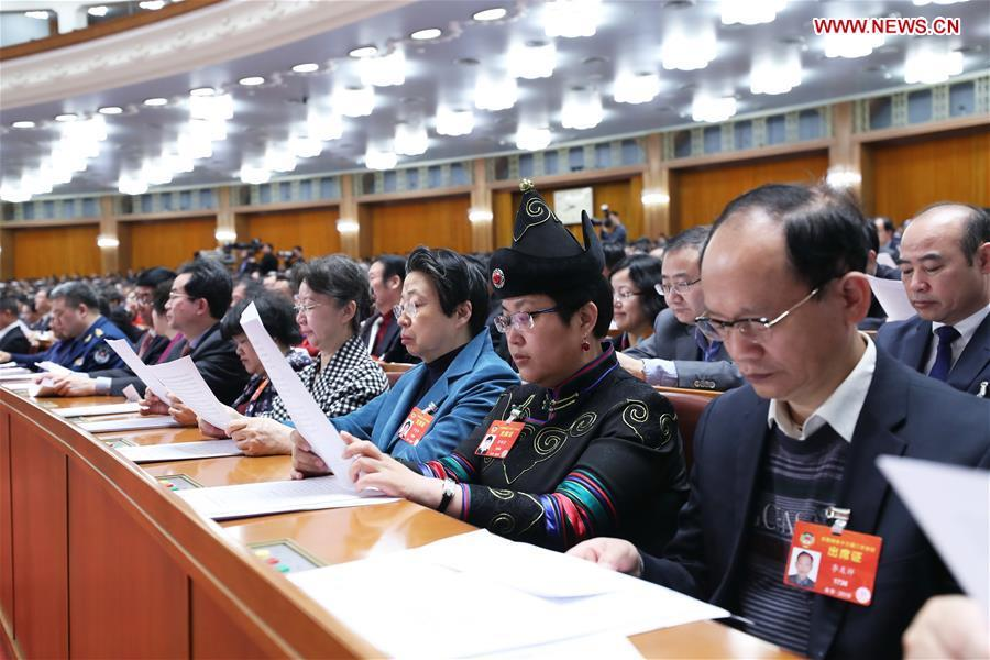 Members of the 13th National Committee of the Chinese People\'s Political Consultative Conference (CPPCC) attend the closing meeting of the second session of the 13th CPPCC National Committee at the Great Hall of the People in Beijing, capital of China, March 13, 2019. (Xinhua/Wang Ye)