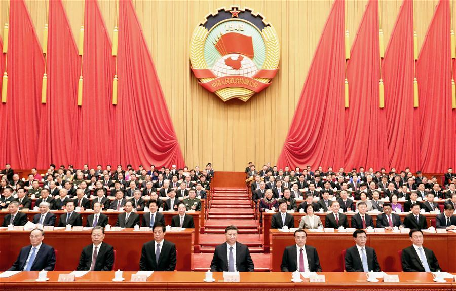 Xi Jinping (C, front), Li Keqiang (3rd R, front), Li Zhanshu (3rd L, front), Wang Huning (2nd R, front), Zhao Leji (2nd L, front), Han Zheng (1st R, front) and Wang Qishan (1st L, front) attend the closing meeting of the second session of the 13th National Committee of the Chinese People\'s Political Consultative Conference (CPPCC) at the Great Hall of the People in Beijing, capital of China, March 13, 2019. (Xinhua/Huang Jingwen)