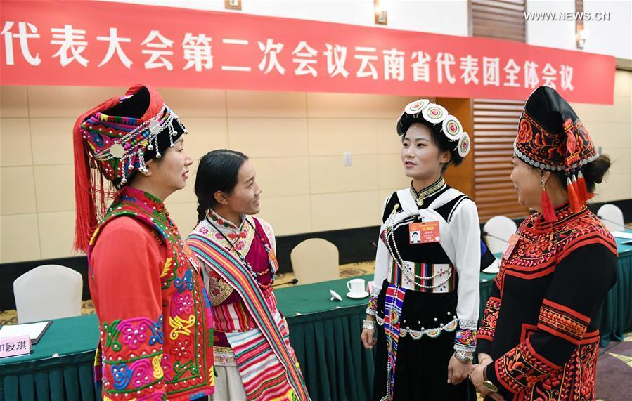 Fan Yongzhen (2nd R), a deputy to the 13th National People\'s Congress (NPC), talks with her fellow deputies after a plenary meeting of Yunnan delegation in Beijing, capital of China, March 7, 2019. (Xinhua/Yang Zongyou)  Sitting among nearly 3,000 national lawmakers at the Great Hall of the People at the heart of Beijing, Fan Yongzhen feels a great sense of responsibility to her people.  A deputy curator of a local cultural museum in southwest China\'s Yunnan Province, Fan wants more funding for preserving ethnic minority cultures, as well as better technologies in public museums in less developed areas.  The annual \