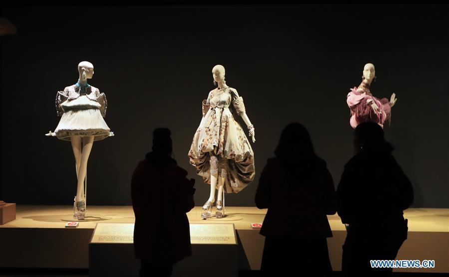 People watch creations of Chinese couturier Guo Pei at her \