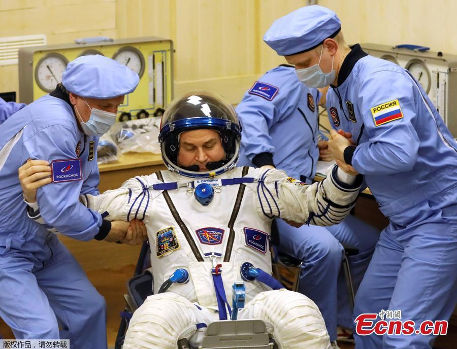 The International Space Station (ISS) crew member Aleksey Ovchinin of Russia is assisted during his space suit check at the Baikonur Cosmodrome, Kazakhstan March 14, 2019. (Photo/Agencies)