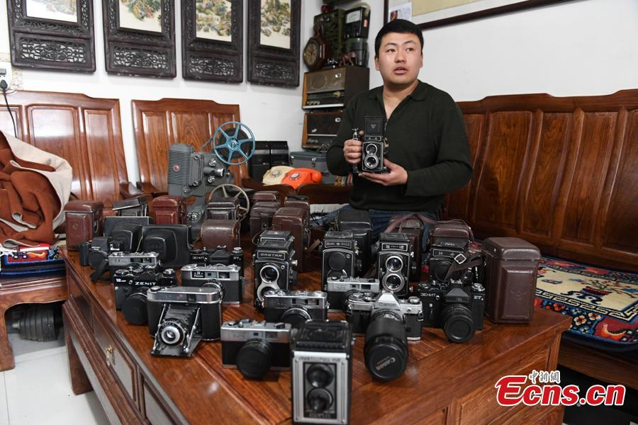 Ma Qianrong shows his collection of old-fashioned cameras in Lanzhou City, Northwest China's Gansu Province, March 14, 2019. Ma began the collection as a child, and today he has amassed more than 1,200 old-fashioned cameras, including brands from Germany, Japan and the United States, dating back to the beginning of the last century to the 1990s. (Photo: China News Service/Yang Yanmin)