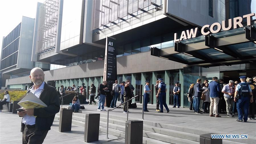 Media crews wait in front of a court in Christchurch, New Zealand, on March 16, 2019. A 28-year-old man was due to appear in a court in Christchurch on Saturday morning, in connection with the mass shootings in the New Zealand city on Friday. (Xinhua/Li Huizi)