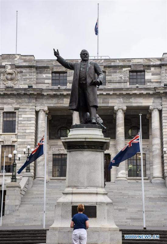 A New Zealand\'s national flag flies at half-mast in front of the parliament buildings in Wellington, capital of New Zealand, on March 16, 2019. Gunmen opened fire in two separate mosques in Christchurch on Friday, killing 49 people and wounding 48 others. (Xinhua/Guo Lei)
