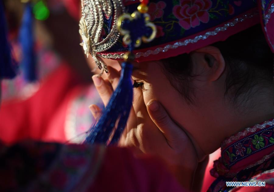 The bride is seen at a wedding ceremony in Mianhua Village of Siba Township of Luocheng Mulao Autonomous County, south China\'s Guangxi Zhuang Autonomous Region, March 17, 2019. A traditional wedding ceremony of the Mulao ethnic group is held here on Sunday. (Xinhua/Meng Zengshi)