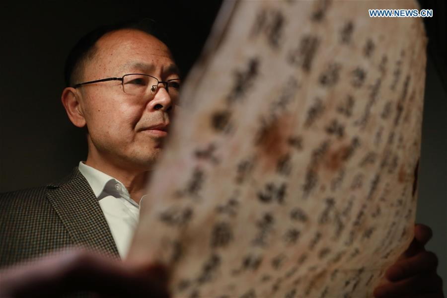 Wang Zongxun, curator of a museum of Jinping Writs, reads a document at the museum in Jinping County, southwest China\'s Guizhou Province, March 18, 2019. Dating back to the Ming Dynasty (1368-1644), \