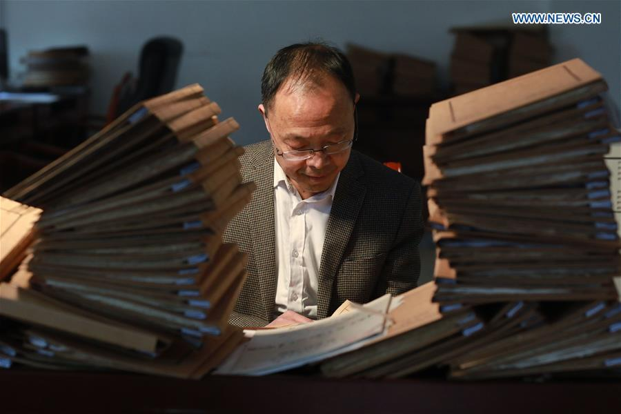 Wang Zongxun, curator of a museum of Jinping Writs, reviews archives of the documents at the museum in Jinping County, southwest China\'s Guizhou Province, March 18, 2019. Dating back to the Ming Dynasty (1368-1644), \