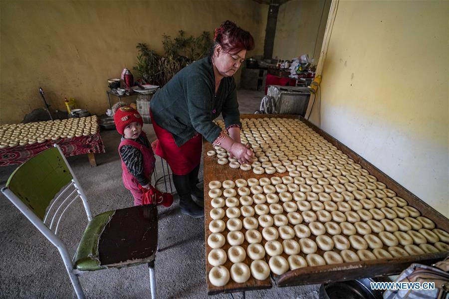 A woman makes doughs of \