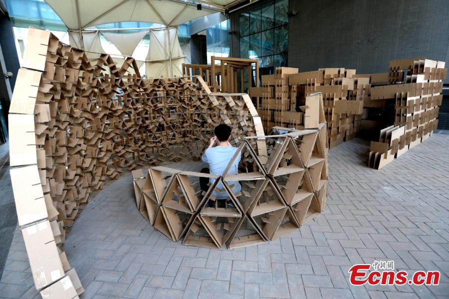 Art installations made using carton board are on display at the Museum of Xi\'an Jiaotong University in Xi\'an City, Shaanxi Province, March 18, 2019. Students used carton board to form small creations that feature ideas such as time travel. (Photo: China News Service/Zhang Yuan)