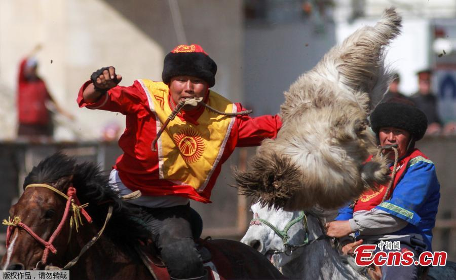 Horsemen take part in a Kok-boru, or goat dragging competition as part of Navruz celebrations, an ancient holiday marking the spring equinox, in Bishkek, Kyrgyzstan, March 18, 2019. (Photo/Agencies)