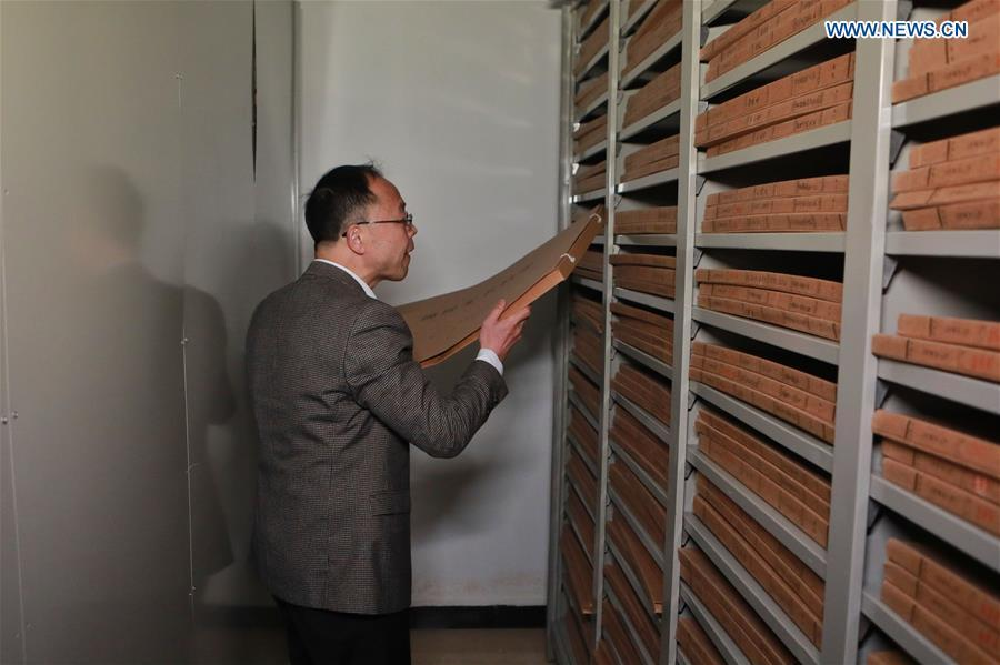 Wang Zongxun, curator of a museum of Jinping Writs, files archives of the documents at the museum in Jinping County, southwest China\'s Guizhou Province, March 18, 2019. Dating back to the Ming Dynasty (1368-1644), \