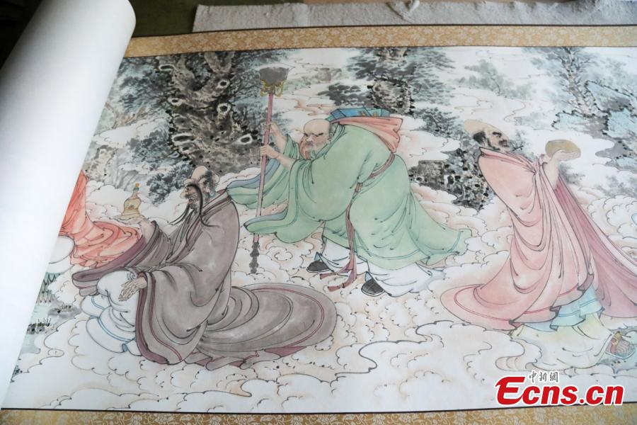 A close-up view of a painting made by Zhang Zhanping in Daixian County, Xinzhou City, North China\'s Shanxi Province, March 18, 2019. The 66-year-old farmer, also a local folk artist specializing in the making and painting of Buddhist sculptures, said he spent eight years creating nine scrolls, each weighing five kilograms and measuring 69 centimetres in width. The total length of the scrolls measured more than 300 meters. He also said he had attempted to apply for a Guinness World Record. (Photo: China News Service/Wang Bintian)