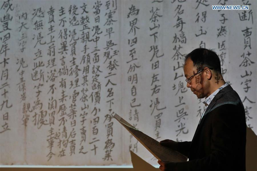 Wang Zongxun, curator of a museum of Jinping Writs, displays a digitalized document at the museum in Jinping County, southwest China\'s Guizhou Province, March 18, 2019. Dating back to the Ming Dynasty (1368-1644), \