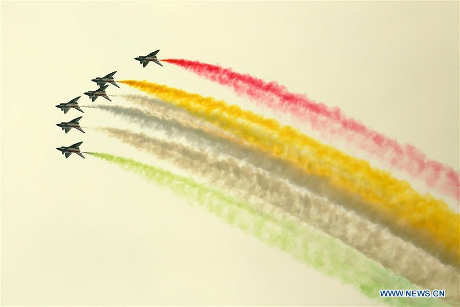 J-10 fighter jets of China\'s Bayi Aerobatic Team perform during the rehearsal of the Pakistan National Day army parade in Islamabad, capital of Pakistan, March 18, 2019. Pakistan National Day, also known as Pakistan Resolution Day or Republic Day, is celebrated annually on March 23. (Xinhua/Ahmad Kamal)