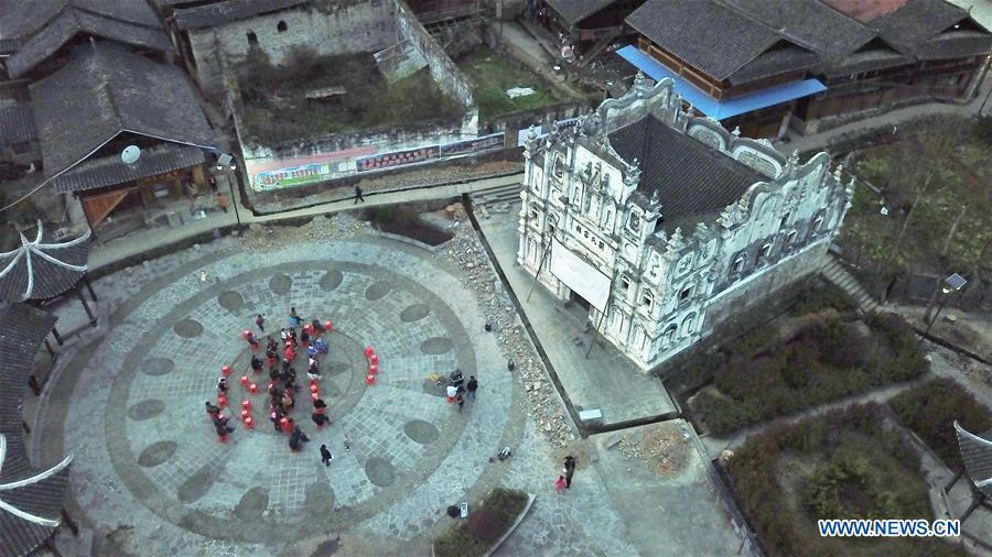 Aerial photo shows villagers of Santangmen Village watching a movie in Santangmen Village of Benchu Town, Tianzhu County of Miao and Dong Autonomous Prefecture of Qiandongnan, southwest China\'s Guizhou Province, March 19, 2019. Local authority in Tianzhu County established special fund to show movies in rural areas. In 2018, a total of 14 voluntary projectionists in Tianzhu showed 3,979 movies in villages within the county. (Xinhua/Ou Dongqu)