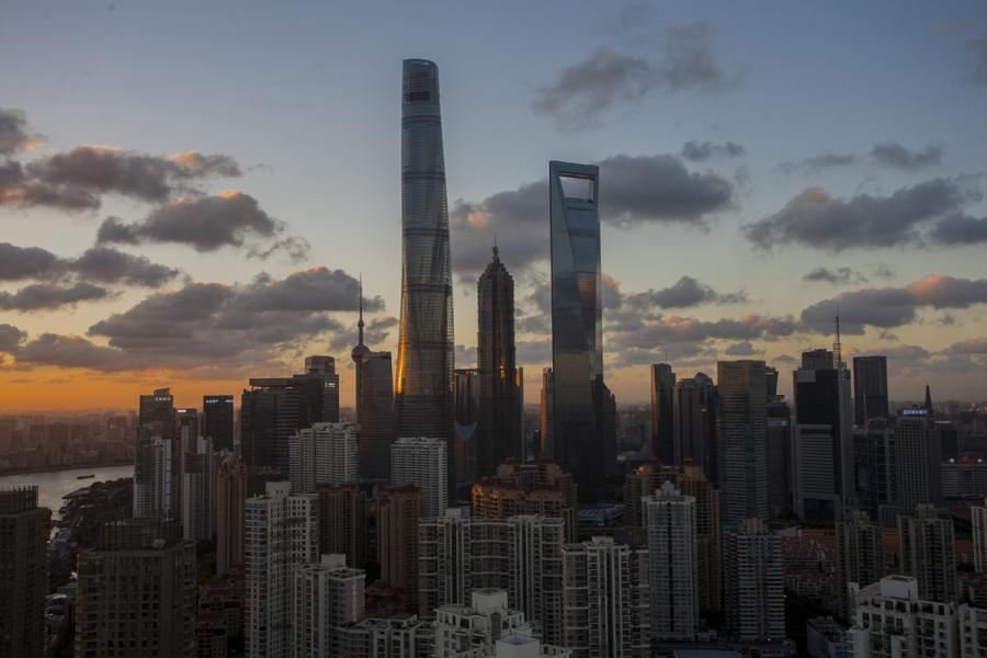 Jinmao Tower was surpassed by the 492-meter Shanghai World Financial Center in 2007 and the 632-meter Shanghai Tower in 2015. The three buildings create the world\'s first trio of adjacent supertall skyscrapers.  (Photo by Zheng Xianzhang/for chinadaily.com.cn)