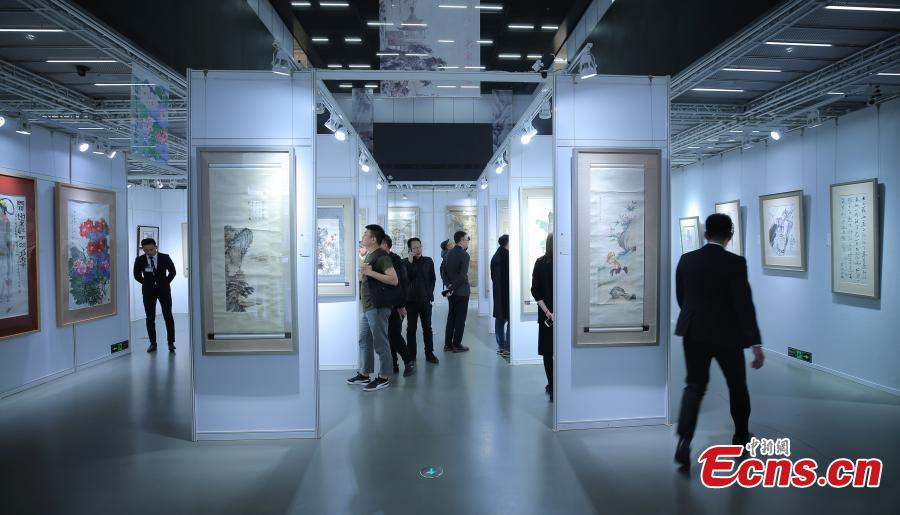 Visitors look at items on display ahead of the 53th China Guardian Quarterly Auctions in Beijing, March 20, 2019. China Guardian said more than 4,000 items, including Chinese paintings and calligraphy, rare books, letters and manuscripts, pieces of porcelain and jade, and other works of art, will be put up for auction from March 23 to 25. (Photo: China News Service/Yang Kejia)