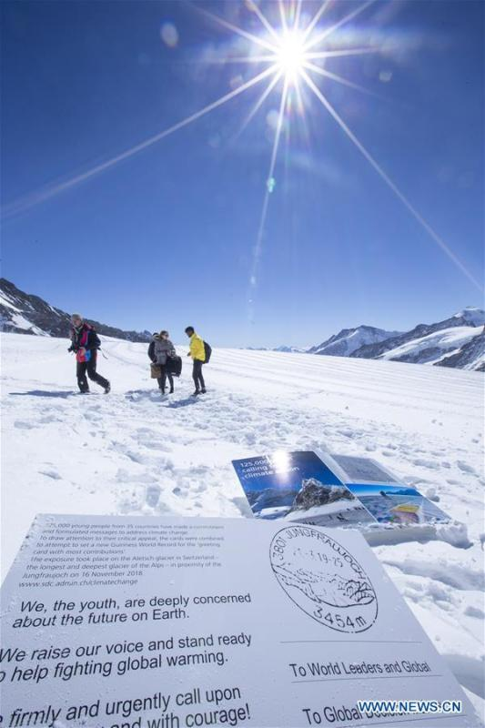 Copies of a postcard calling for action against climate change are seen on the Aletsch glacier under Jungfraujoch in Switzerland, on March 20, 2019. Some 900 postcards from youths all over the world were stamped and sent on Wednesday from Europe\'s highest postbox on the Jungfraujoch peak, Switzerland, to global leaders, calling for action against climate change. (Xinhua/Xu Jinquan)