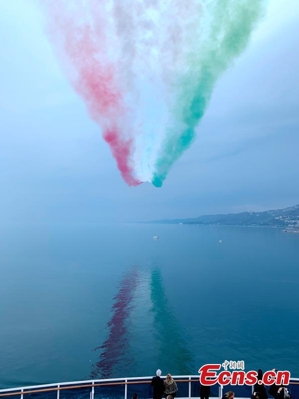 The aerobatic demonstration team Frecce Tricolori performs as part of celebrations for the naming of Costa Venezia, the first Costa ship built specifically for the Chinese market, in Trieste, Italy, March 1, 2019. (Photo: China News Service/Peng Dawei)