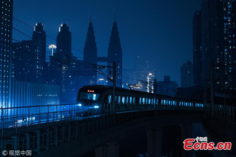 Photo shows a train leaving a subway station in Southwest China\'s Chongqing, on March 11, 2019. Haitangxi Station, a light rail station on a loop line in Chongqing, became popular online for its vibrant appearance at night.  (Photo/VCG)