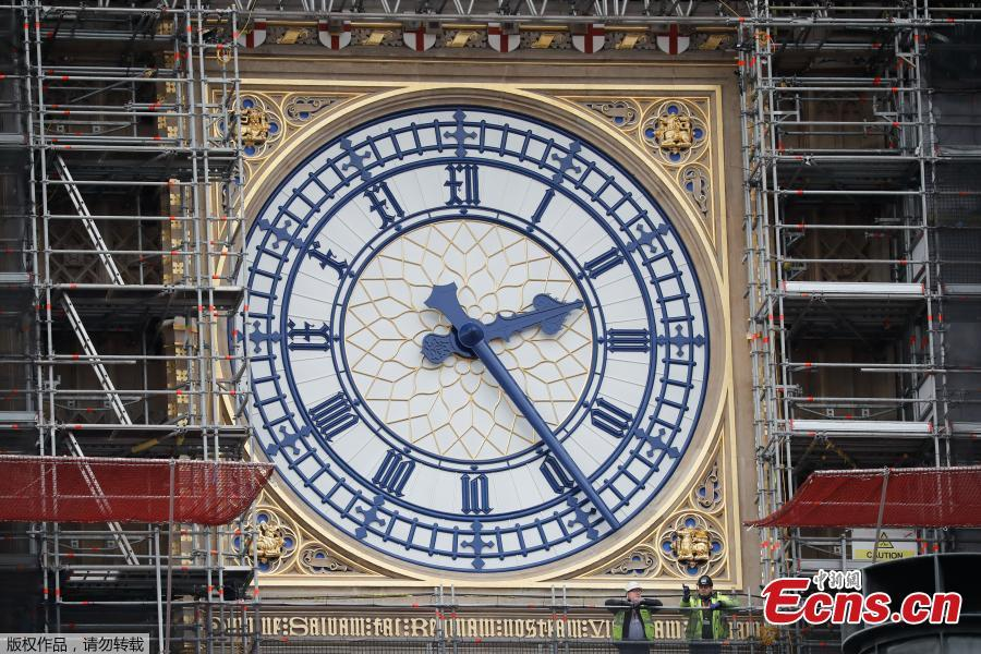 <?php echo strip_tags(addslashes(Photo taken on March 22, 2019 shows part of the clock tower revealed for the first time since restoration work began in 2017. And it shows a mostly blue face. (Photo/Agencies) 