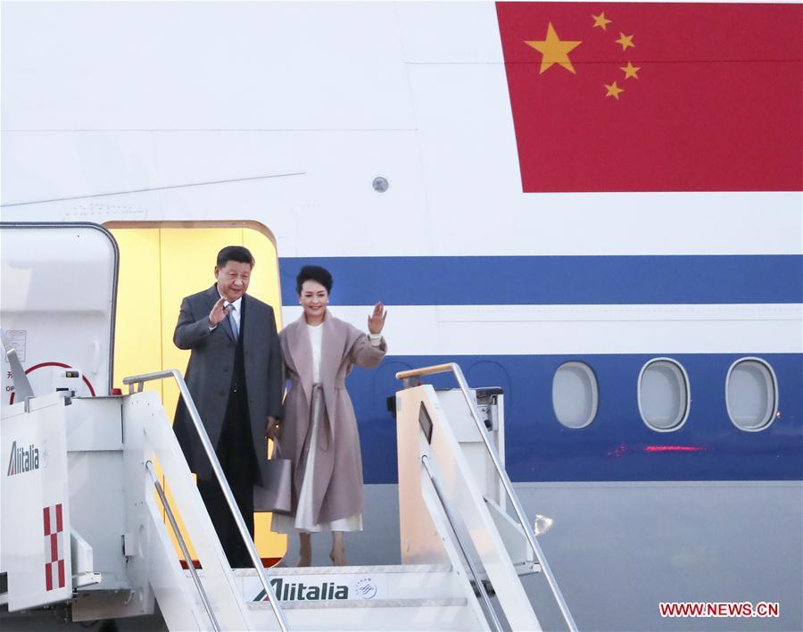 Chinese President Xi Jinping (L) and his wife Peng Liyuan disembark from the airplane upon their arrival in Rome, Italy, on March 21, 2019. Xi arrived in Rome Thursday for a state visit to Italy to map out the future of the bilateral relationship and move it into a new era. (Xinhua/Wang Ye)