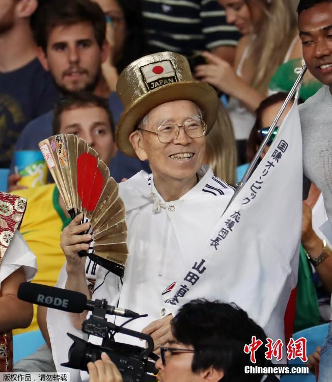 This August 18, 2016 picture shows Naotoshi Yamada, a Japanese Olympic mega-fan, in Rio de Janeiro. Japan\'s \