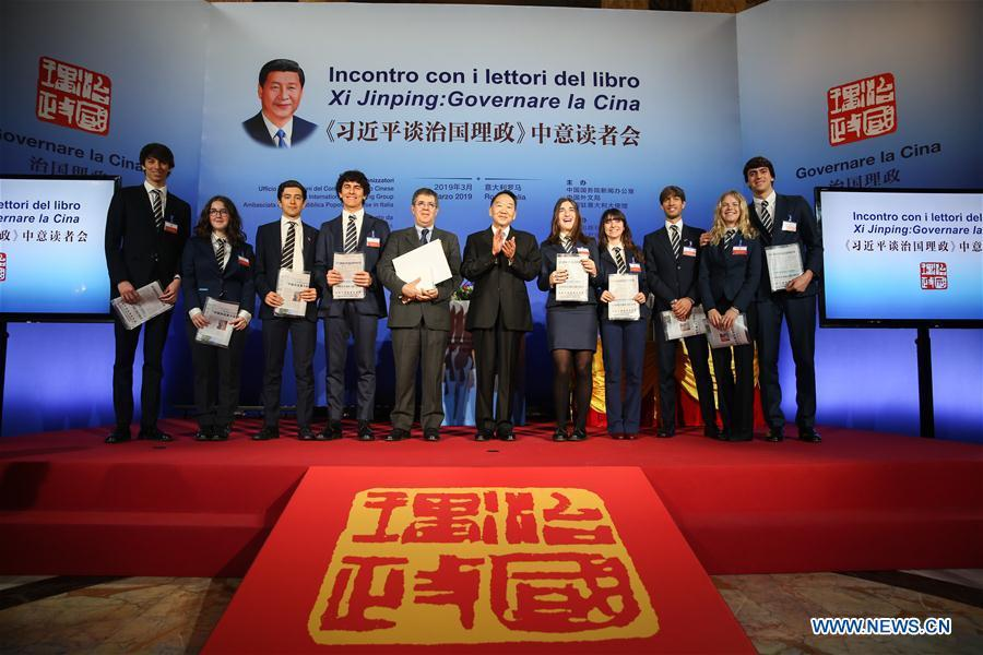 Jiang Jianguo (C), deputy head of the Publicity Department of the Communist Party of China Central Committee, and Paolo M. Reale (5th, L), president of Rome Convitto Nazionale Vittorio Emanuele II, an Italian boarding school, pose for a photo with Italian sutdents at a seminar on \